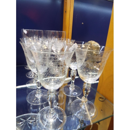 48 - A set of six wheel engraved wine glasses with baluster stems together with four Edinburgh cut crysta...