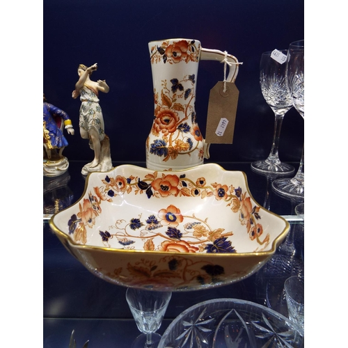 49 - A Wedgwood 'Old Derby' pattern shaped bowl and jug decorated in Imari style flowers...