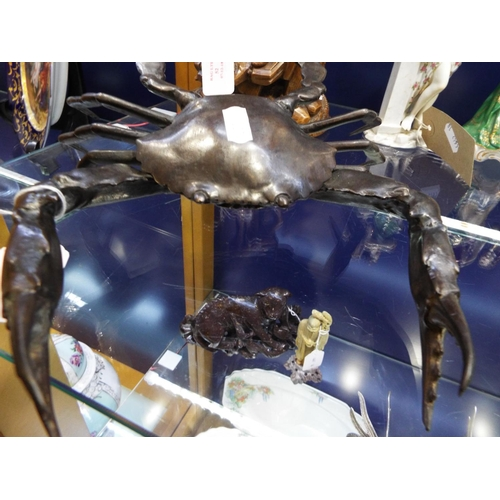 53 - A 20thC hollow cast bronze model of a crab with pincers raised, unsigned...