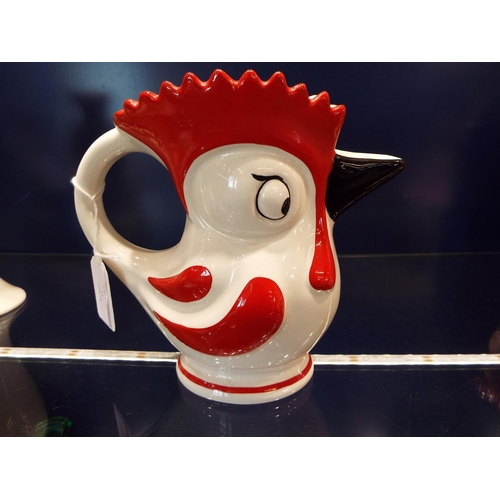 11 - A 1950's Burlington novelty chick jug in red, black and cream glazes...