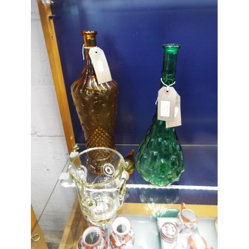 13 - Two green and amber embossed glass ornamental vases together with an art glass vase...