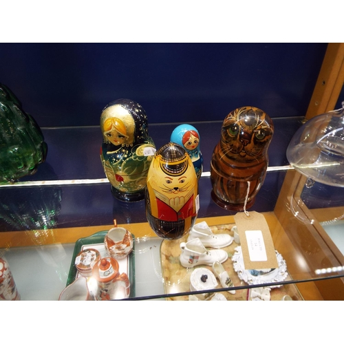 14 - Four Russian Matroyshka nesting dolls and cats, two signed, one with label to base...