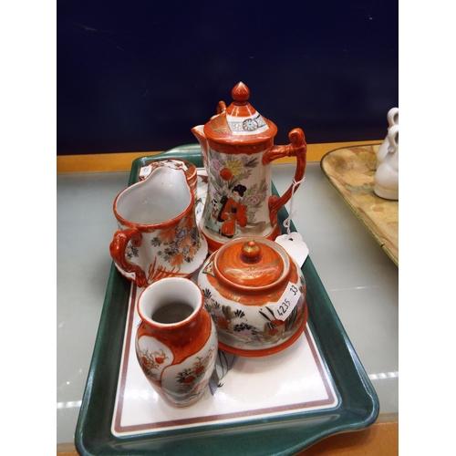 17 - A mixed selection of Kutani jugs, tea pot, bowls, lidded pot, marks to base...