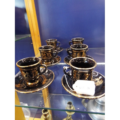 22 - A set of six black and 24k gold 'Neofitou' ceramic coffee cups and saucers...
