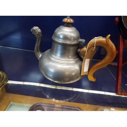 26 - A late 19thC pewter teapot of bell shaped form, the spout modelled as a pheasant's head...