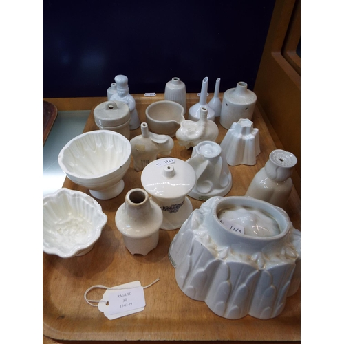 30 - A selection of vintage ceramic jelly moulds and pie funnels to include a pair of funnels in the form...