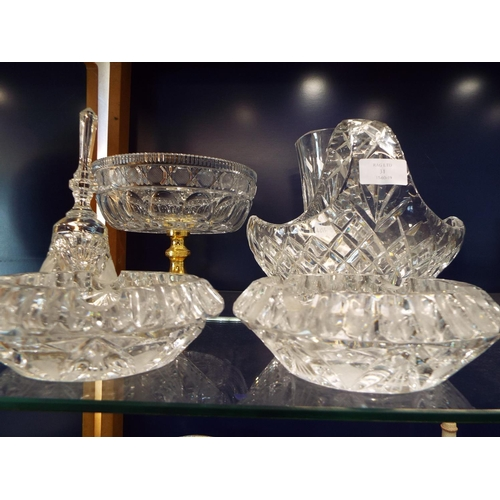 31 - A selection of cut and crystal glass to include vase, basket comport, bell and ashtrays...