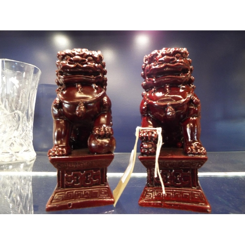 32 - A pair of good quality Chinese red lacquered Dogs of Fo raised on plinth bases...