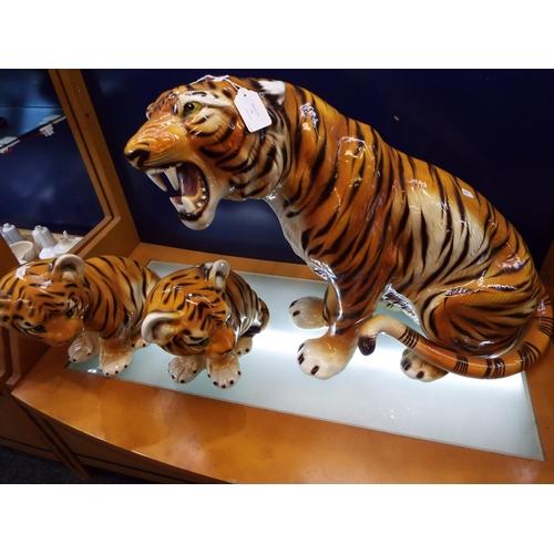 38 - Three large Portuguese C. L. F. Faiancas models of a 'Tigress and Her Cubs'...