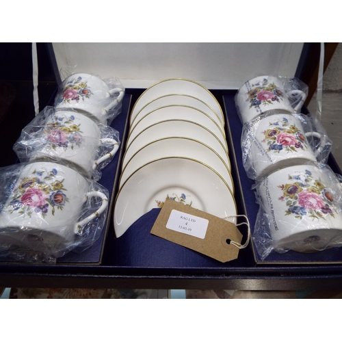 4 - A boxed Royal Worcester floral decorated coffee set...