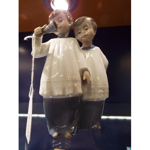 42 - A Nao figurine group of two 'Choir Boys' with bell...