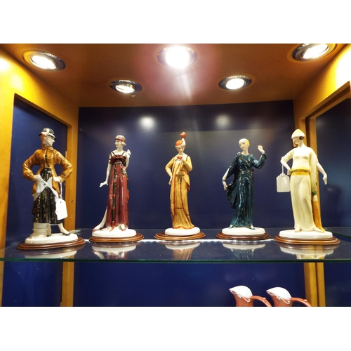 55 - A group of Cemark International 'Edwardian' hand-painted porcelain figures...