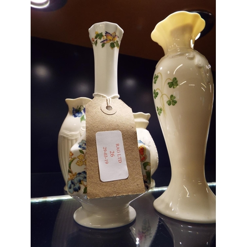 26 - A modern Belleek vase decorated with pansies together with two Donegal floral vases and an Aynsley c...