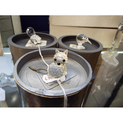 29 - Three Swarovski figures to include 'Beaver', 'Cat' and retired 'Kiwi' figurines all complete with bo...