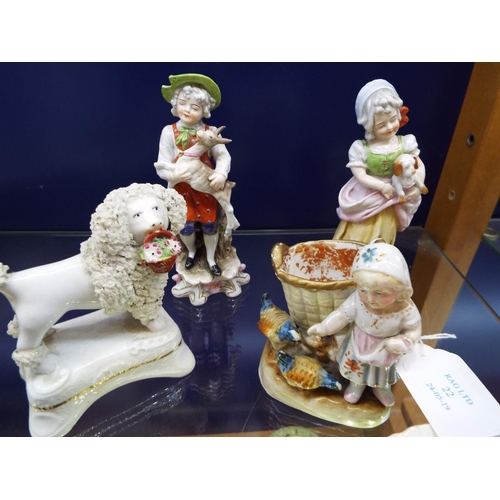22 - Three continental porcelain figures and a poodle...