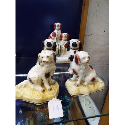 35 - Two pairs of Staffordshire spaniels and another...