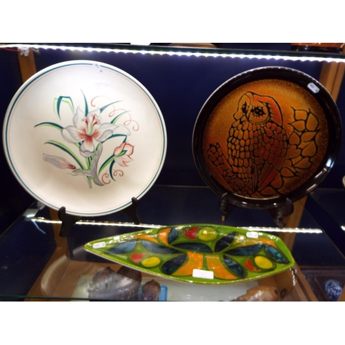 20 - A Poole Pottery 'Aegean', charger with owl decoration and another with floral decoration...