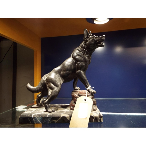 58 - A 1920's/30's spelter model of a German Shepherd raised on a rocky base and moulded on a marble plin...