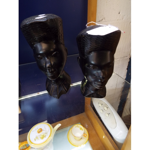 31 - A pair of carved hardwood bust of tribal females...