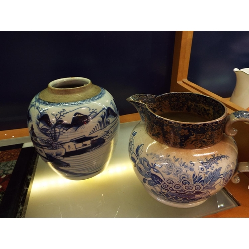 22 - A blue and white water jug and a Delft style vase...