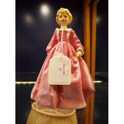 49 - A Royal Worcester figurine of a young lady...