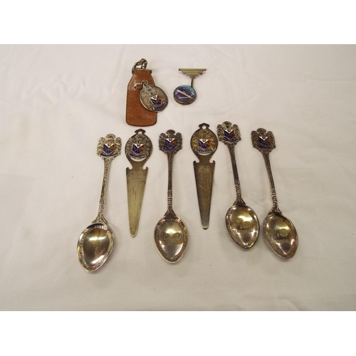 136 - A selection of P&O souvenir items to include four silver spoons, two silver bookmarks, a silver Art ...