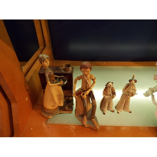 17 - Four pottery figures depicting a female baking, man with beer and two clowns
