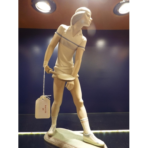 19 - A Lladro figurine of a male 'Tennis Player', marks to base 12