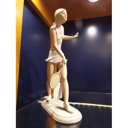 20 - A Lladro figurine of a female 'Tennis Player, marks to base 11