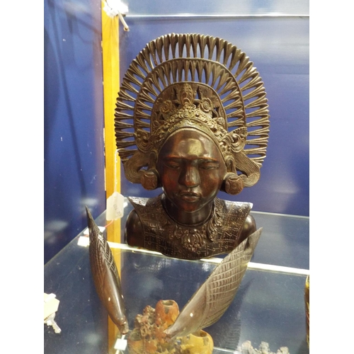 23 - A vintage Bali hand carved wooden bust of a female together with two carved wooden fish