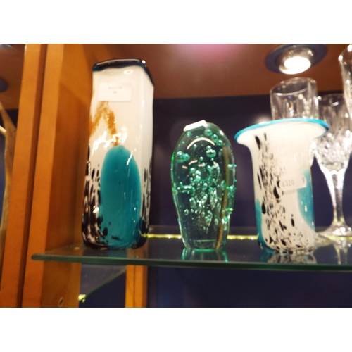 30 - A green glass dump with bubble inclusions and two Mdina glass vases