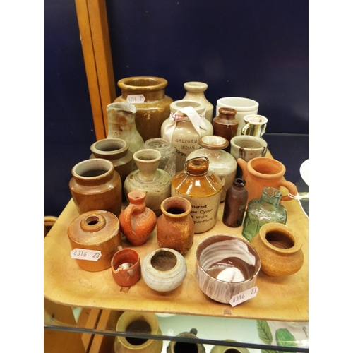34 - A mixed selection of assorted stoneware jars and bottle