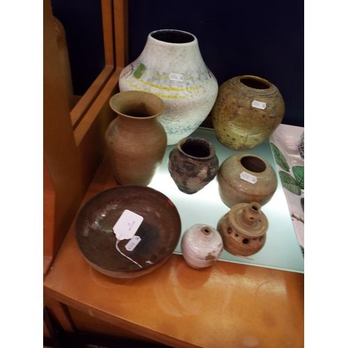 37 - A mixed selection of assorted stoneware vases together with another