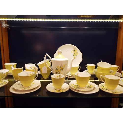 42 - A Royal Albert bone china yellow glazed and floral decorated tea set