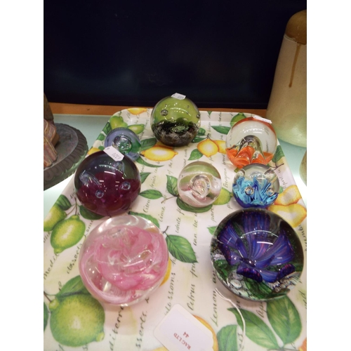 44 - A selection of assorted glass paperweights to include Caithness (8)