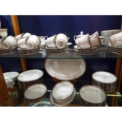 50 - A large selection of Noritake 'Elenor' dinner and tea ware comprising of cups, saucers, bowls, side ...