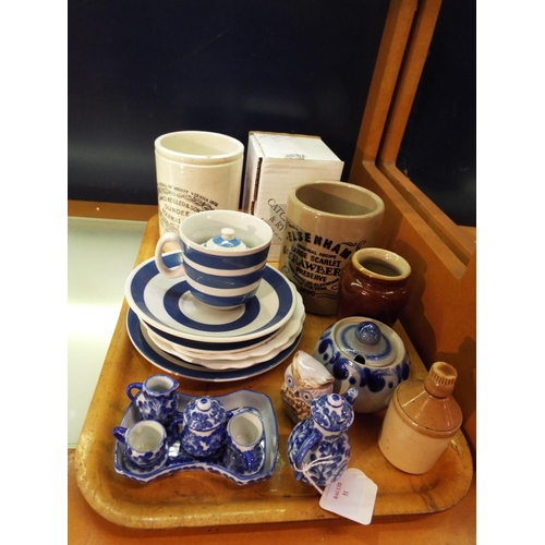 51 - A mixed selection of assorted blue and white china, stoneware advertising pots etc