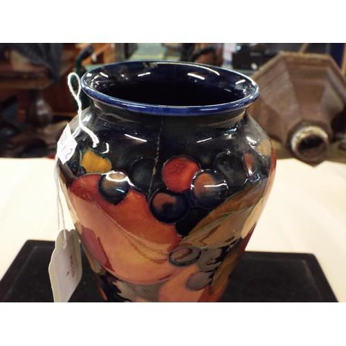4 - A William Moorcroft 'Pomegranate' decorated vase A/F