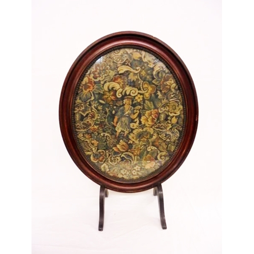 14 - Oval Fire Screen on cabriole supports with machine made tapestry of figure amongst flowers...