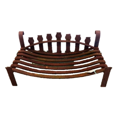 17 - Large Slatted Wrought Iron Log Grate with upstand, on scrolling supports...
