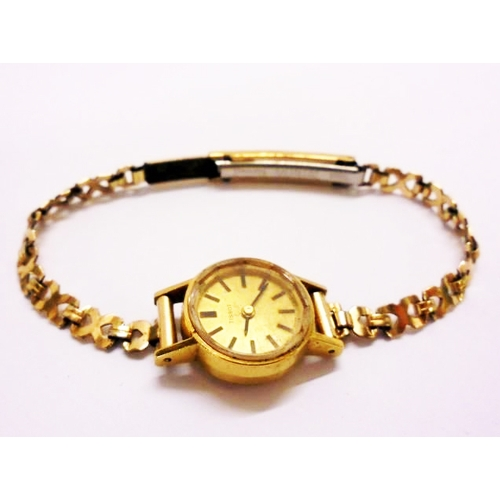 419 - Ladies 18ct Gold Tissot Wristwatch with gilt strap, gold dial, baton markers...