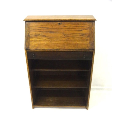 22 - Oak Students Bureau with open bookshelves, fall enclosing pigeon holes with single drawer...