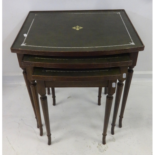 4 - Nest of 3 Bow Fronted Tables with inset tooled leather surfaces, on turned supports...