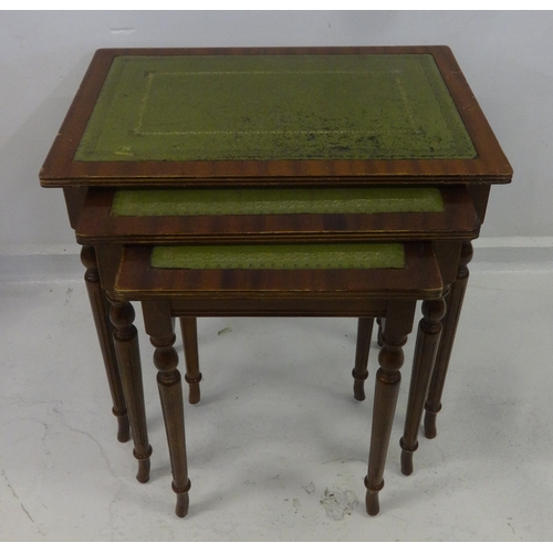 31 - Nest of 3 Rectangular Occasional Tables inset green tooled leather, on turned supports...