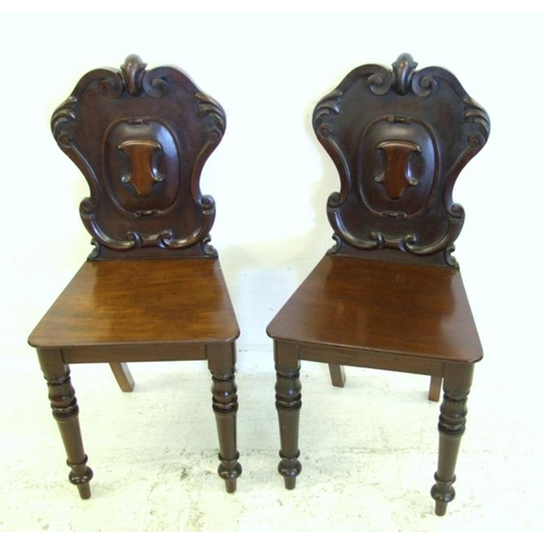 20 - Pair C19th Heavy Quality Mahogany Hall Chairs on turned & carved front supports with cartouche shiel...