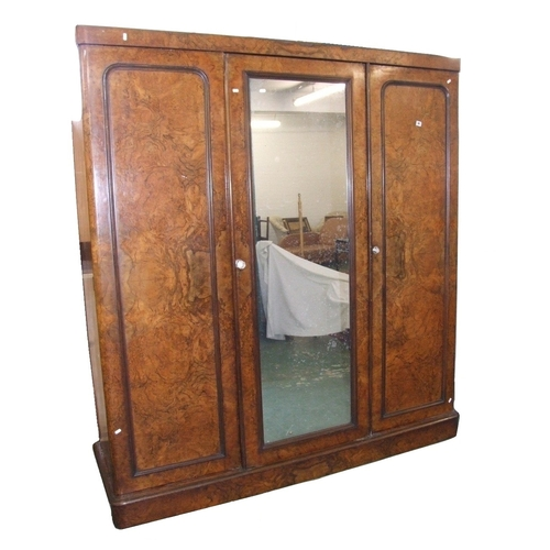 36 - Mid Victorian Burr & Figured Walnut Wardrobe on plinth base, left hand section with panelled door & ...