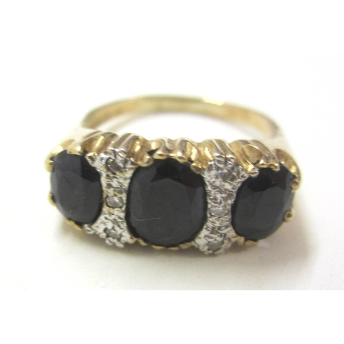 421 - 9ct Yellow Gold Ladies Ring set 3 large sapphires interspaced with diamond points, size S...
