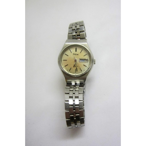 412 - Pulsar Ladies Stainless Steel Wristwatch, silvered dial, baton markers, day/date with articulated st...