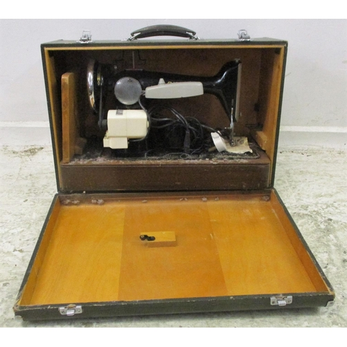 10A - Singer Electric Sewing Machine in faux crocodile skin case...