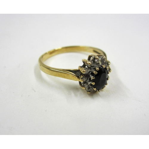421 - Ladies 9ct Gold Sapphire & Diamond Cluster Ring with central oval facet cut sapphire with 12 diamond...
